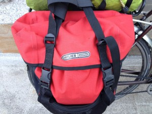 Ortlieb panniers - not low cost, even second hand from ebay, but 100% per cent waterproof.